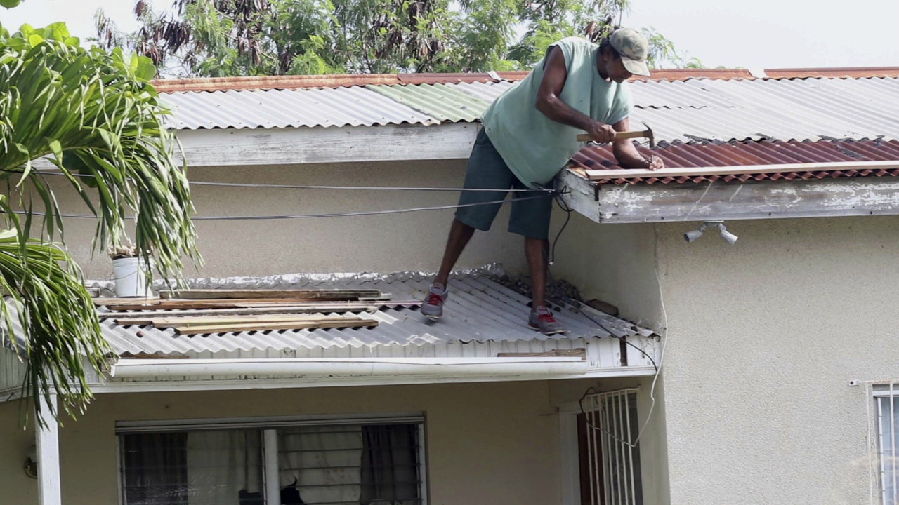 A resident of Antigua making preparations on Tuesday for the passage of Hurricane Irma.