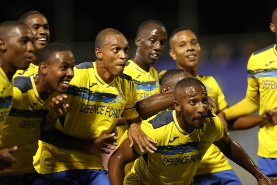Defence Force players celebrate scoring against North East Stars in the final of the 2016 First Citizens Cup en route lifting the trophy at the Hasely Crawford Stadium on Dec. 2, 2016.
