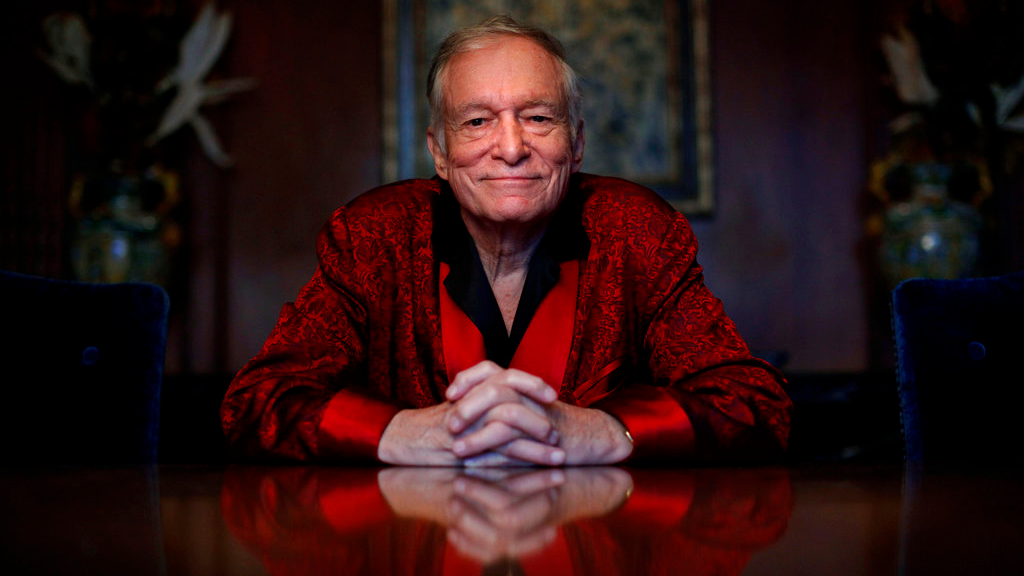 FILE - In this Nov. 4, 2010, file photo, Playboy magazine founder Hugh Hefner poses for photos at the Playboy Mansion in Los Angeles. (AP Photo/Jae C. Hong, File)