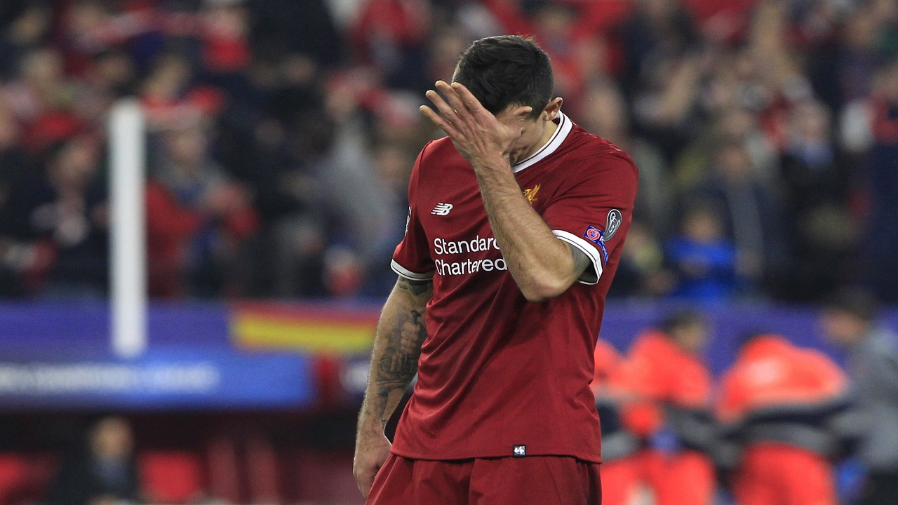 Liverpool's Dejan Lovren reacts at the end of a Champions League group E football match against Sevilla  at the Ramon Sanchez Pizjuan stadium in Seville, Spain, Tuesday, Nov. 21, 2017. Sevilla tied the game 3-3 in the last minute.
