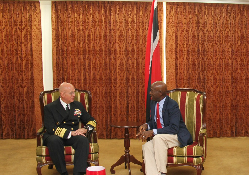 Commander Admiral Kurt Tidd of the US Southern Command (left), Prime Minister Dr Keith Rowley (right).