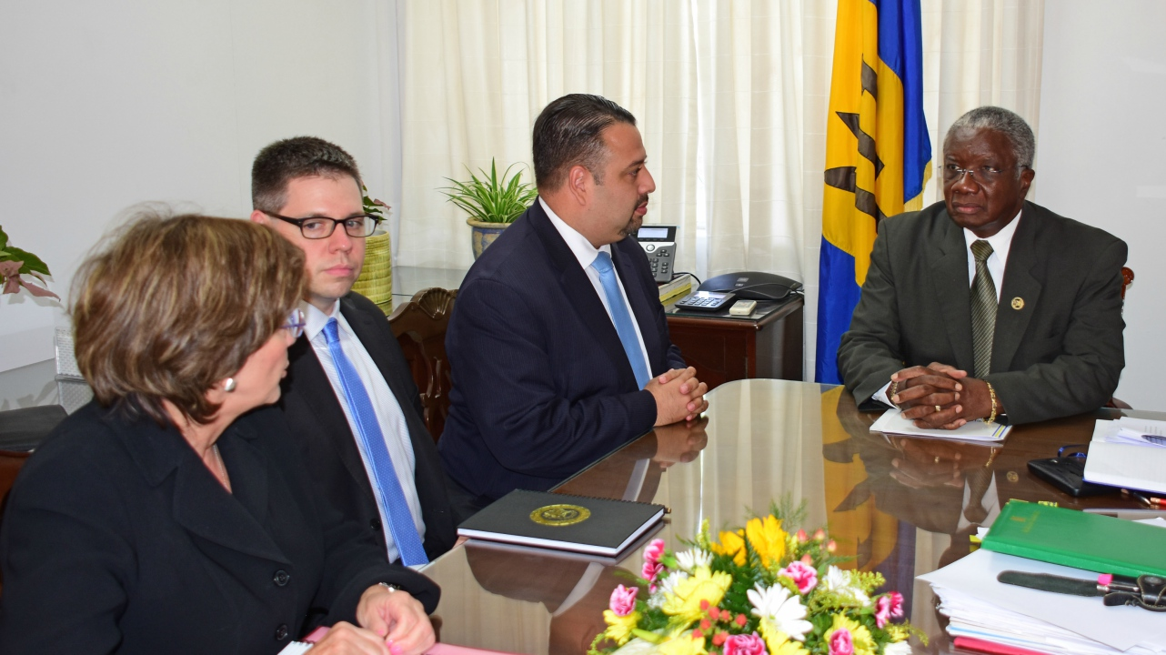 Prime Minister Freundel Stuart listening attentively to US officials Eddy Acevedo (to Mr. Stuart's right), Eric Jacobstein, and Ambassador Linda Taglialatela. (BGIS Photo)