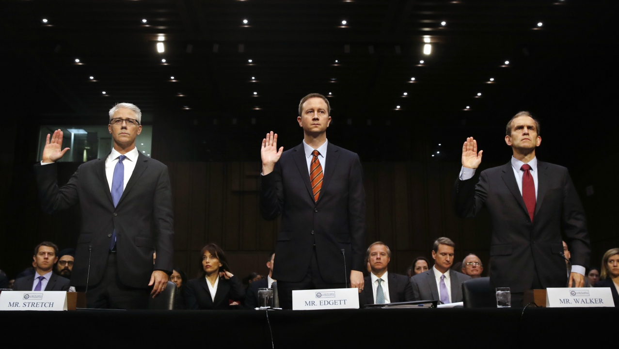 From left, Facebook's General Counsel Colin Stretch, Twitter's Acting General Counsel Sean Edgett, and Google's Senior Vice President and General Counsel Kent Walker, are sworn in for a Senate Intelligence Committee hearing on Russian election activity and technology, Wednesday, Nov. 1, 2017, on Capitol Hill in Washington. (AP Photo/Jacquelyn Martin)