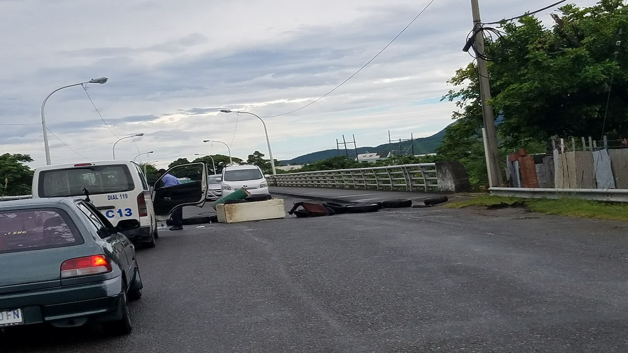 The entrance to a bridge in St Thomas was blocked on Monday during demonstrations by residents in the parish over the conditions of the roadways.