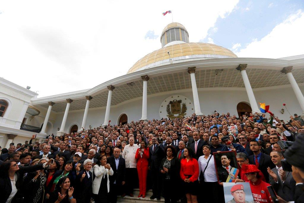 In this Aug. 4, 2017 file photo, Venezuela's Constitutional Assembly poses for an official photo after being sworn in, at the National Assembly in Caracas, Venezuela. (AP Photo/Ariana Cubillos, File)