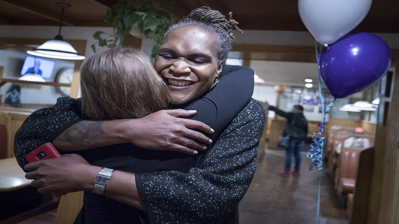 Andrea Jenkins hugs a supporter as she won the Minneapolis Ward 8: Council Member race in Minneapolis on Tuesday, Nov. 7, 2017.