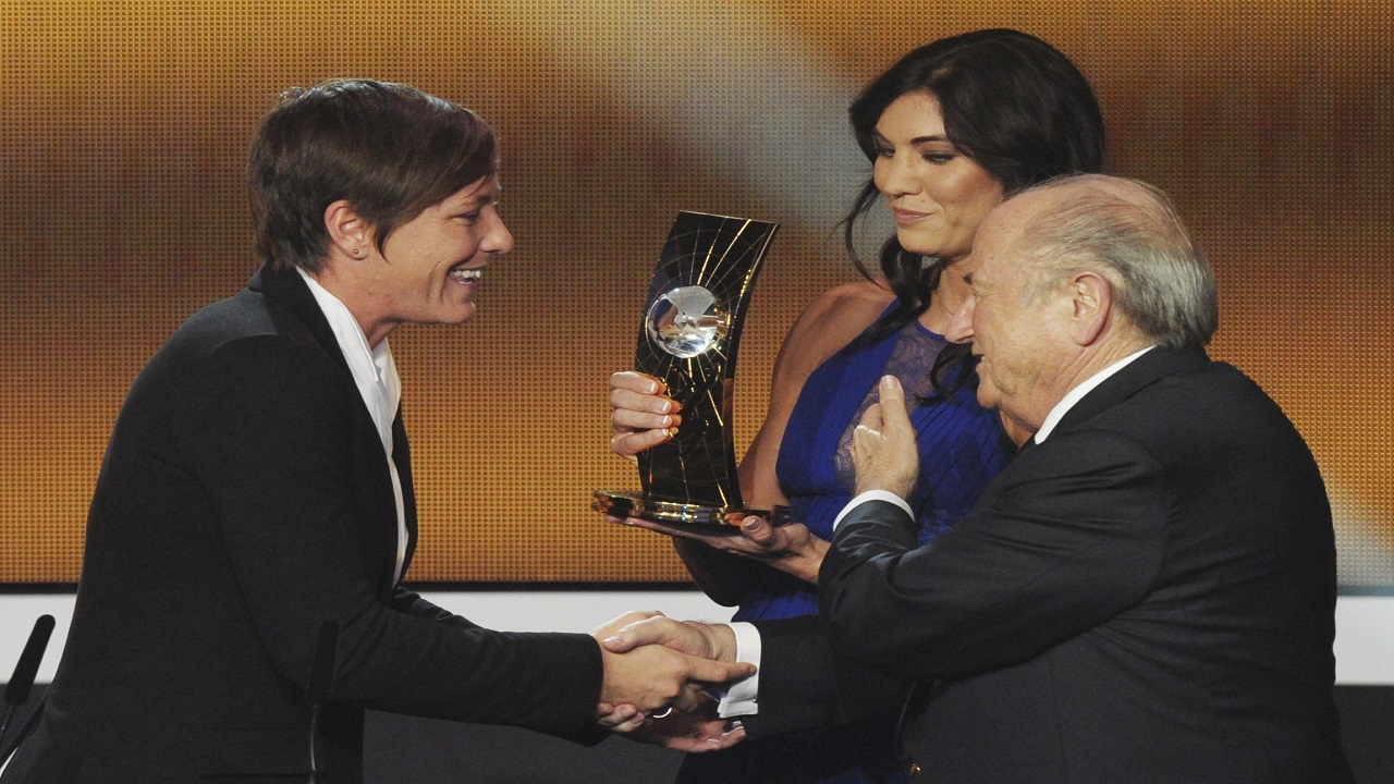 In this January 7, 2013, file photo, Abby Wambach, left, of the United States is presented the FIFA Women's World Player of the Year award by Hope Solo, center, goalkeeper of the U.S. team, and FIFA President Sepp Blatter, right, during the FIFA Ballon d'Or Gala held at the Kongresshaus in Zurich, Switzerland. Solo told a Portuguese newspaper that former FIFA President Blatter sexually assaulted her at the ceremony. (PHOTO:AP)