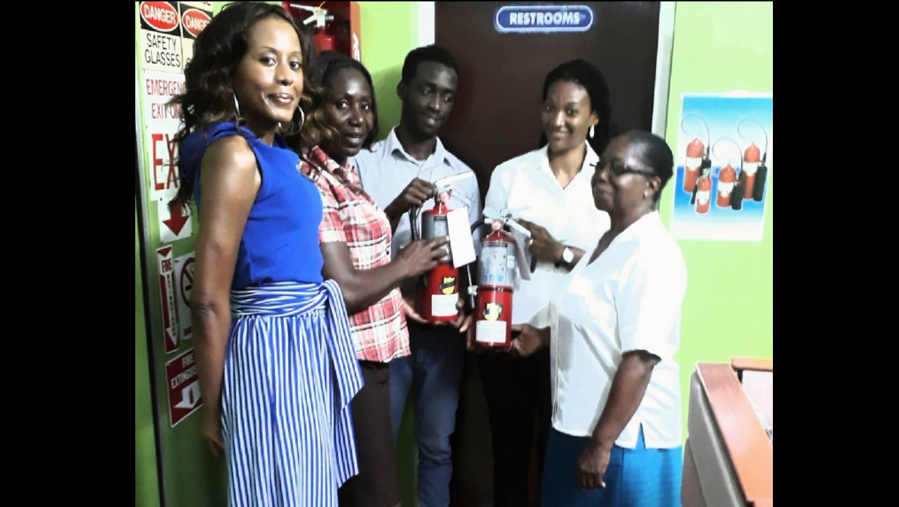 (From left) Rosemary Duncan, Rita Marley Foundation (JA) manager; Mrs Scott, principal of St Issac's Basic School; Christoph Stephens of Jamaica Fire Equipment; Birthwright Forskin, a teacher at Holy Trinity Basic School; and Julet Ellis, Holy Trinity Basic School principal.