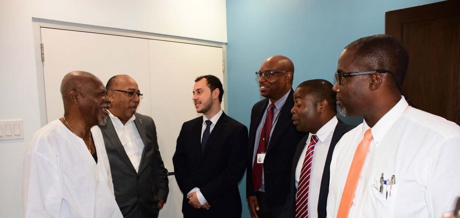 (l-r) Dr. Atlee Brathwaite, Chairman of the Barbados Water Authority (BWA); Minister of Agriculture, David Estwick; John Robert Caruso, Assistant Manager of MASDAR of the United Arab Emirates; BWA General Manager Keithroy Halliday; Nathan Hart, Project Engineer BWA.