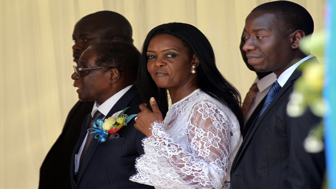 Zimbabwean First Lady Grace Mugabe, center, walks with Zimbabwean President Robert Mugabe at a ceremony to rename Harare International airport to Robert Gabriel Mugabe International Airport in Harare, Thursday. (PHOTO: AP)