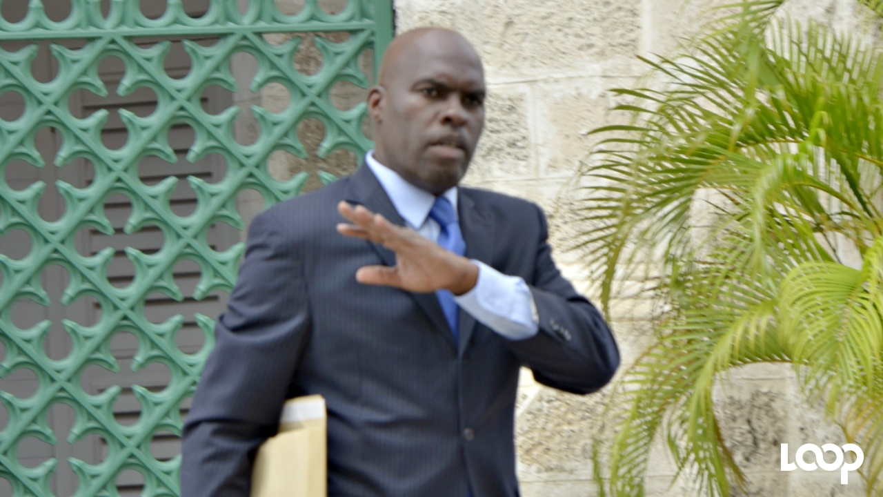 FILE - Minister of Transport and Works, Michael Lashley.
