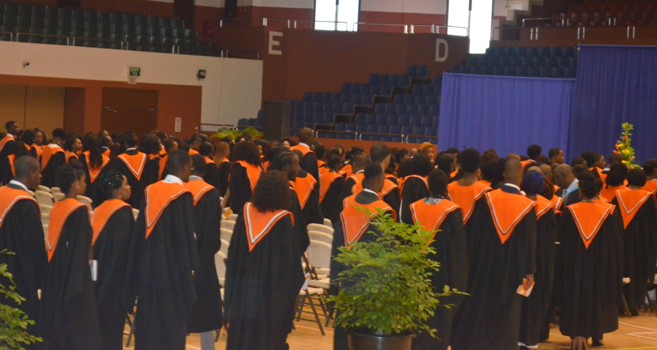 Graduates going to accept their scrolls during the 44th Barbados Communication College Graduation Ceremony at the newly-renovated Garfield Sobers Sports Complex in Wildey.