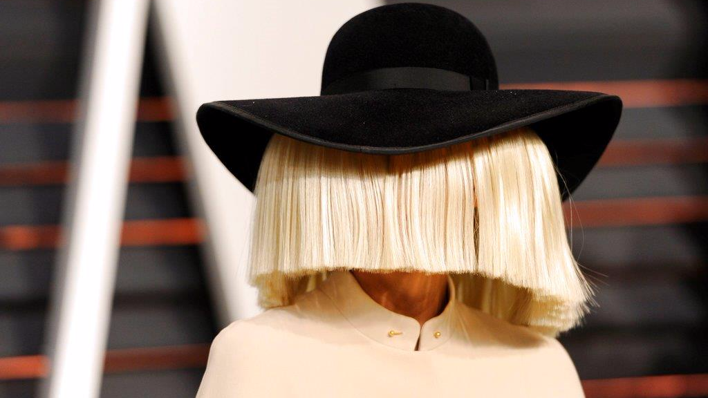 In this Feb. 22, 2015, file photo, Sia arrives at the 2015 Vanity Fair Oscar Party in Beverly Hills, Calif. Sia tweeted a nude photo of herself on Nov. 6, 2017, after learning that someone was trying to sell nude paparazzi photos of her. (Photo by Evan Agostini/Invision/AP, File)