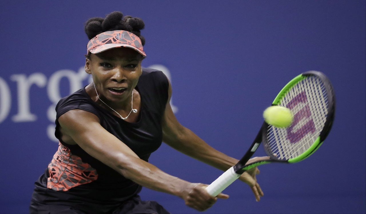 In this Sept. 7, 2017, file photo, Venus Williams, of the United States, returns a shot from Sloane Stephens, of the United States, during the semifinals of the U.S. Open tennis tournament in New York. Williams needed three match points and more than three hours to defeat Jelena Ostapenko 7-5, 6-7 (3), 7-5 at the WTA Finals in Singapore on Tuesday, Ot. 24, 2017.