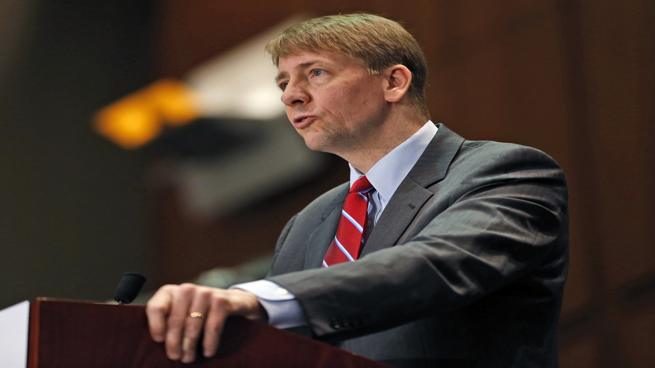 In this March 26, 2015, file photo, Consumer Financial Protection Bureau Director Richard Cordray speaks during a panel discussion in Richmond, Va.
