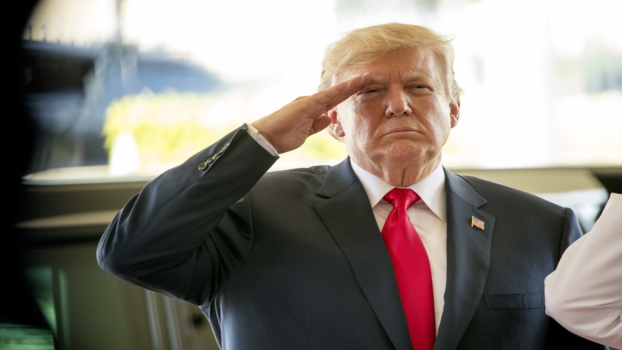 President Donald Trump salutes during a welcome ceremony at U.S. Pacific Command (PACOM), Friday, Nov. 3, 2017, in Aiea, Hawaii. Trump begins a 5 country trip through Asia traveling to Japan, South Korea, China, Vietnam and the Philippians