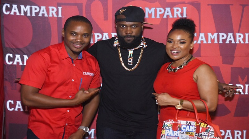 Soca artiste Bunji Garlin (c) hangs out with Campari Regional Marketing Manager Kamal Powell and Regional Commercial Director Michelle Brown at the welcome reception held in his honor on Nov 1 at Jamrock St Lucia.