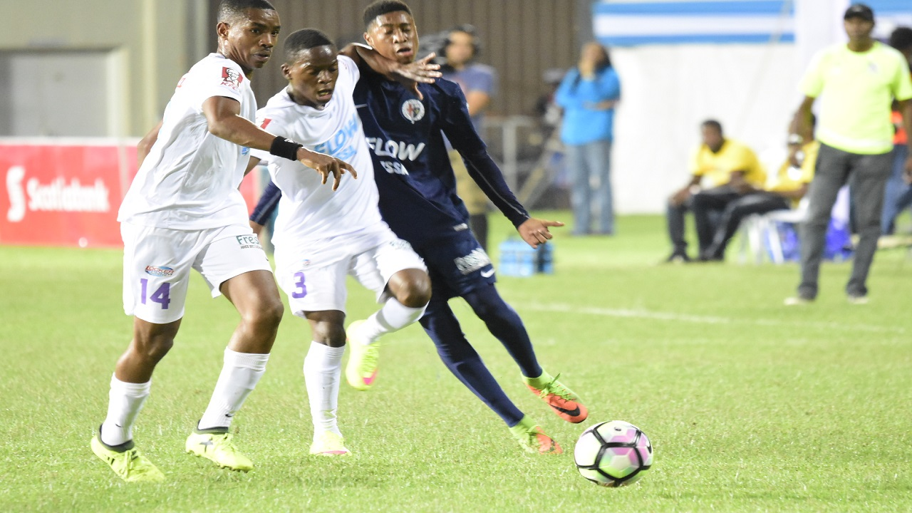 Picture shows action from the ISSA/FLOW Super Cup semi-final match between Kingston  College (KC) and Jamaica College (JC) at Sabina Park in Kingston on Saturday. KC won 2-1.