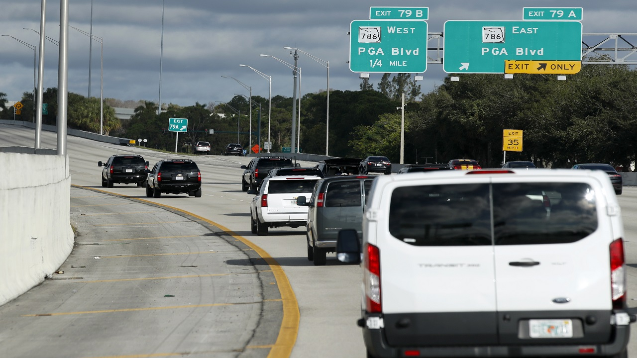 The motorcade for President Donald Trump is seen, Friday, Nov. 24, 2017, in Palm Beach Gardens, Fla. Trump is en route to his Trump National Golf Club, in Jupiter, Fla.