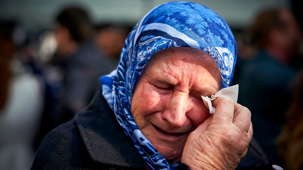 Nura Mustafic, one of the Mothers of Srebrenica and other Bosnian organizations, wipes away tears as she reacts to the verdict which the Yugoslav War Crimes Tribunal, ICTY, handed down in the genocide trial against former Bosnian Serb military chief Ratko Mladic, in The Hague, Netherlands,  A UN court has convicted former Bosnian Serb military chief Gen. Ratko Mladic of genocide and crimes against humanity and sentenced him to life in prison for atrocities perpetrated during Bosnia's 1992-1995 war.