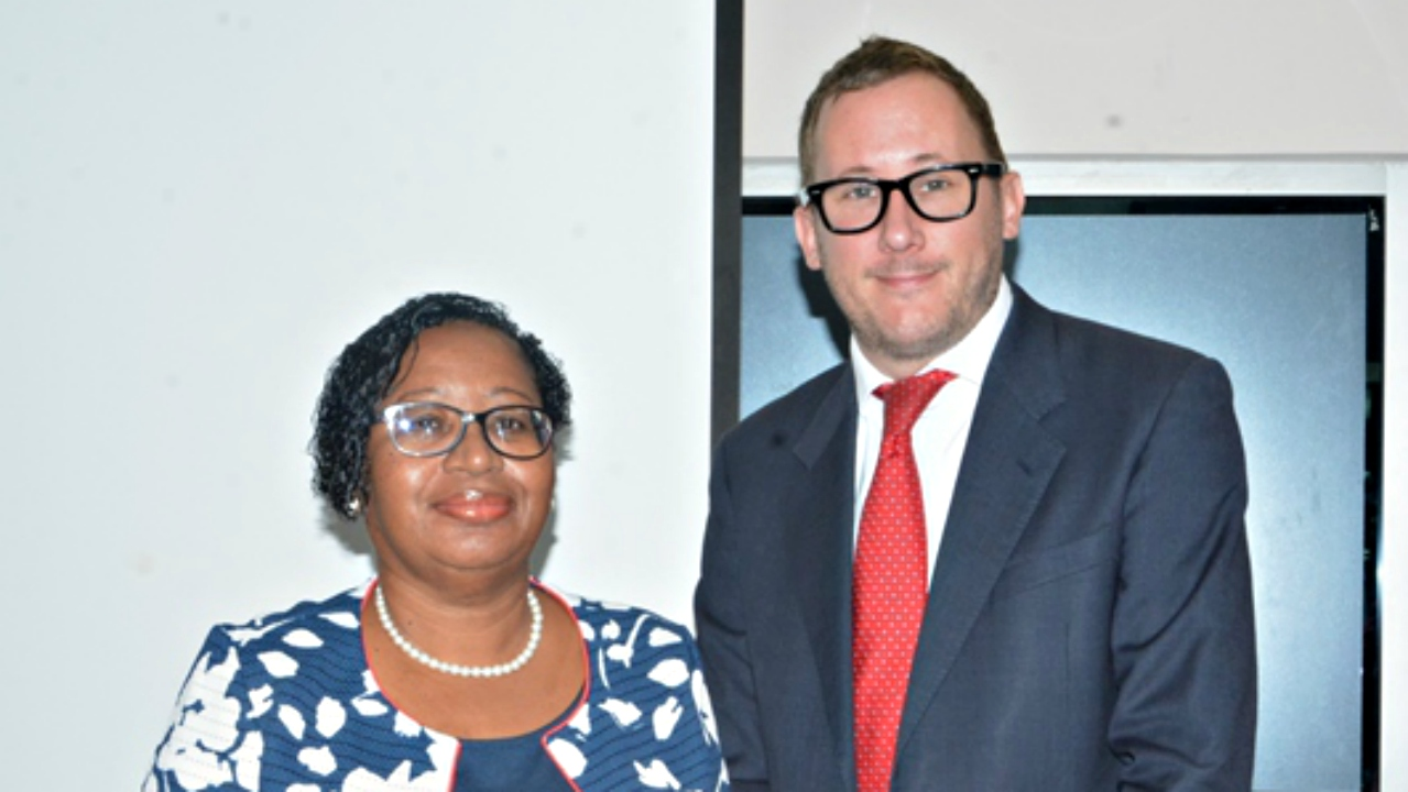 Acting tutor-coordinator of the Women and Development Unit, Cecelia Batson-Rollock, with Head of the Political and Communications team at the British High Commission Bridgetown, Edward Munn.