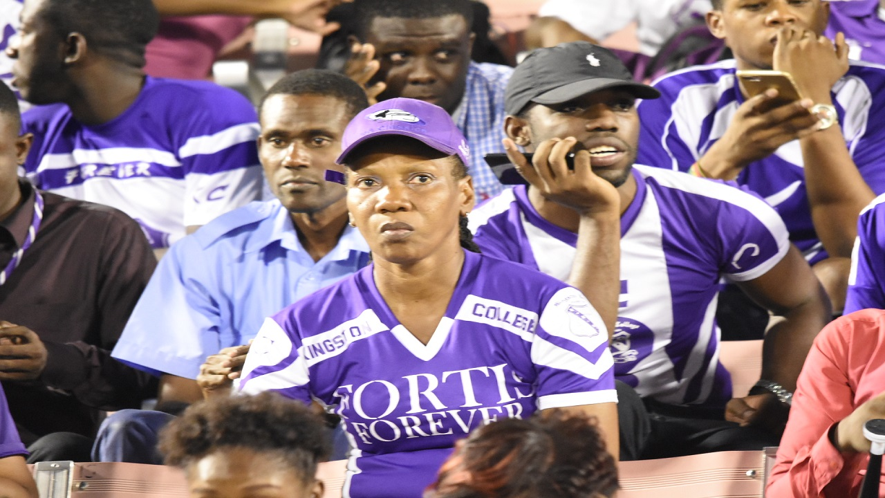 Disappointed Kingston College supporters during the Walker Cup final on Tuesday. (PHOTOS: Marlon Reid)