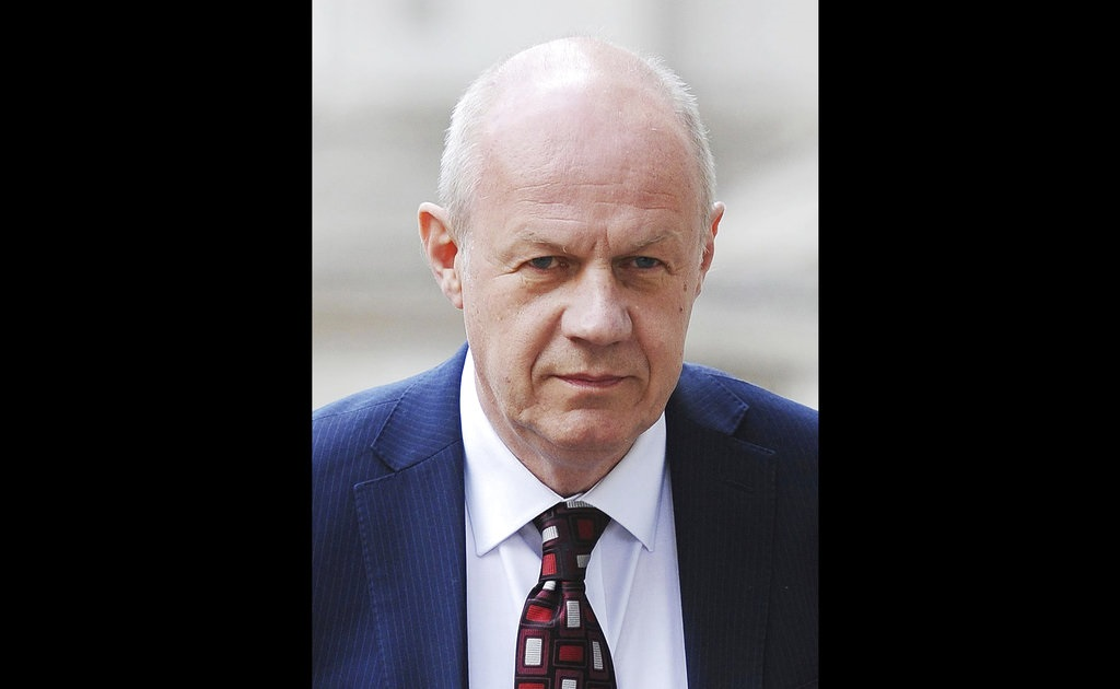 "The scandal surrounding Britain's political class deepened Sunday Nov. 5, 2017, with more allegations of sexual harassment, abuse of power and other misdeeds including new allegations about one of Prime Minister Theresa May's key allies. First Secretary of State Damian Green, a senior Cabinet figure who is in effect May's deputy, denied a Sunday Times claim that police had found ""extreme"" pornography on his computer during an investigation nine years ago. (Andrews Matthews/PA via AP, file)"