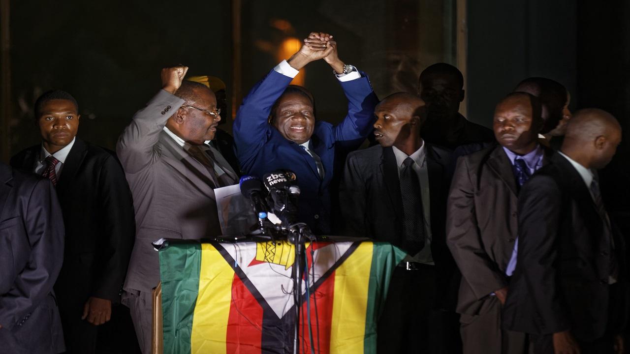 Zimbabwe's President in waiting Emmerson Mnangagwa, greets supporters gathered outside the Zanu-PF party headquarters in Harare, Zimbabwe Wednesday, Nov. 22, 2017.