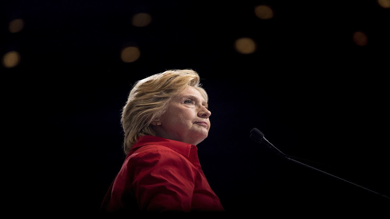 In this Saturday, July 30, 2016 file photo, Democratic presidential candidate Hillary Clinton pauses while speaking at a rally in Pittsburgh during a bus tour through the rust belt.