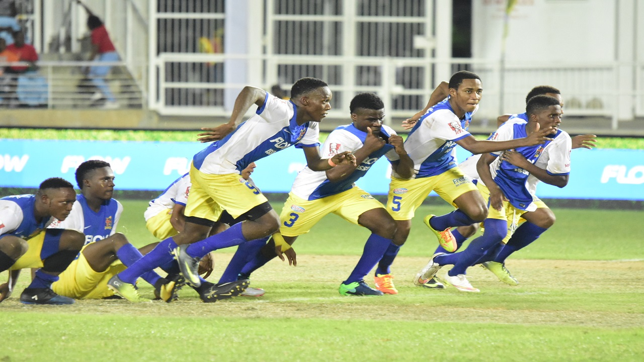 Players from St Elizabeth Technical High School (STETHS) rush to meet their hero following a sudden death penalty shoot-out win over Calabar High in semi-final one of the ISSA/FLOW Super Cup at the National Stadium in Kingston on Saturday.