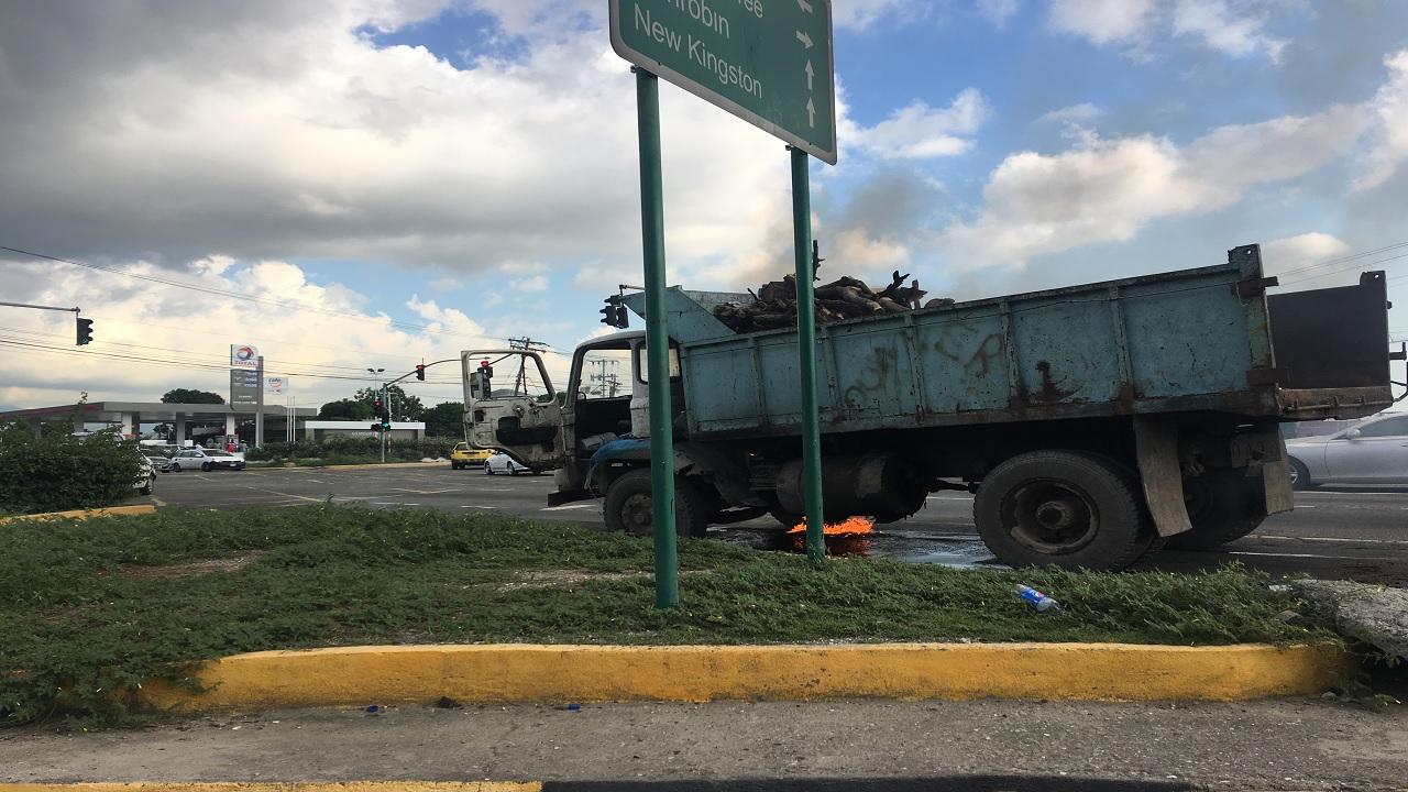 A blaze is seen underneath a truck along Washington Boulevard in St Andrew on Friday.