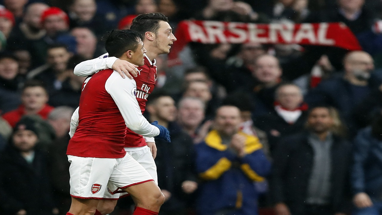 Arsenal's Alexis Sanchez, left celebrates his goal with Arsenal's Mesut Ozil during their English Premier League football match at Emirates stadium in London, Saturday, Nov. 18, 2017.