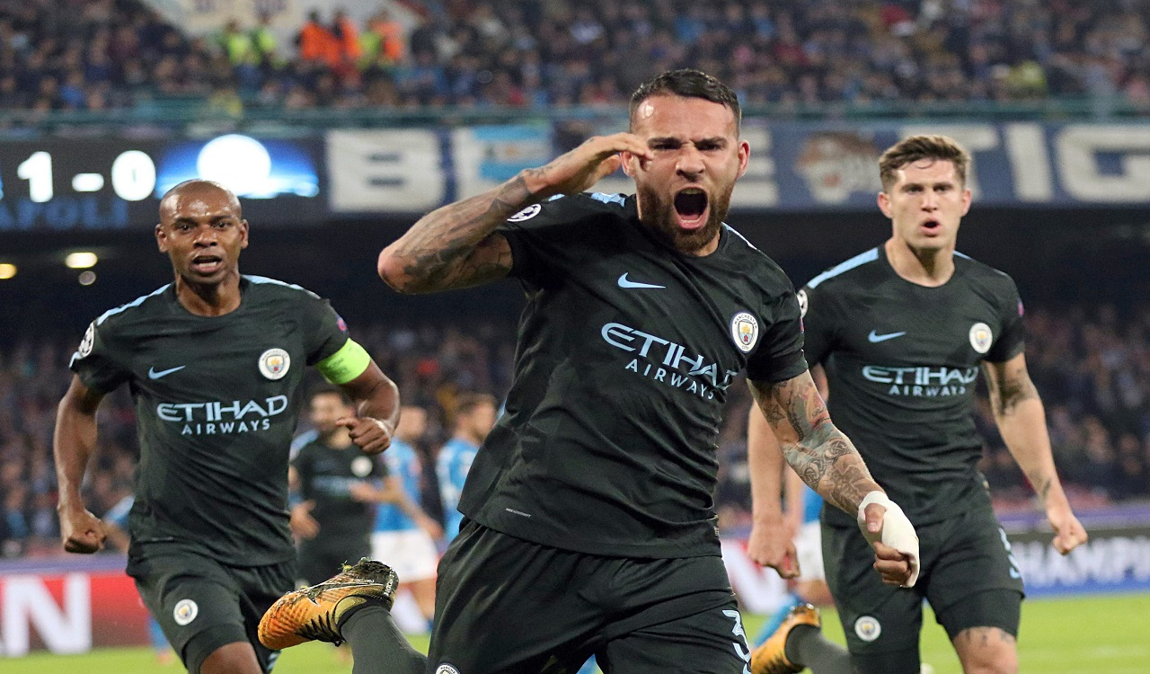 Manchester City's Nicolas Otamendi, foreground, celebrates after scoring during the Champions League Group F football match against Napoli  at the San Paolo stadium in Naples, Italy, Wednesday, Nov. 1, 2017.
