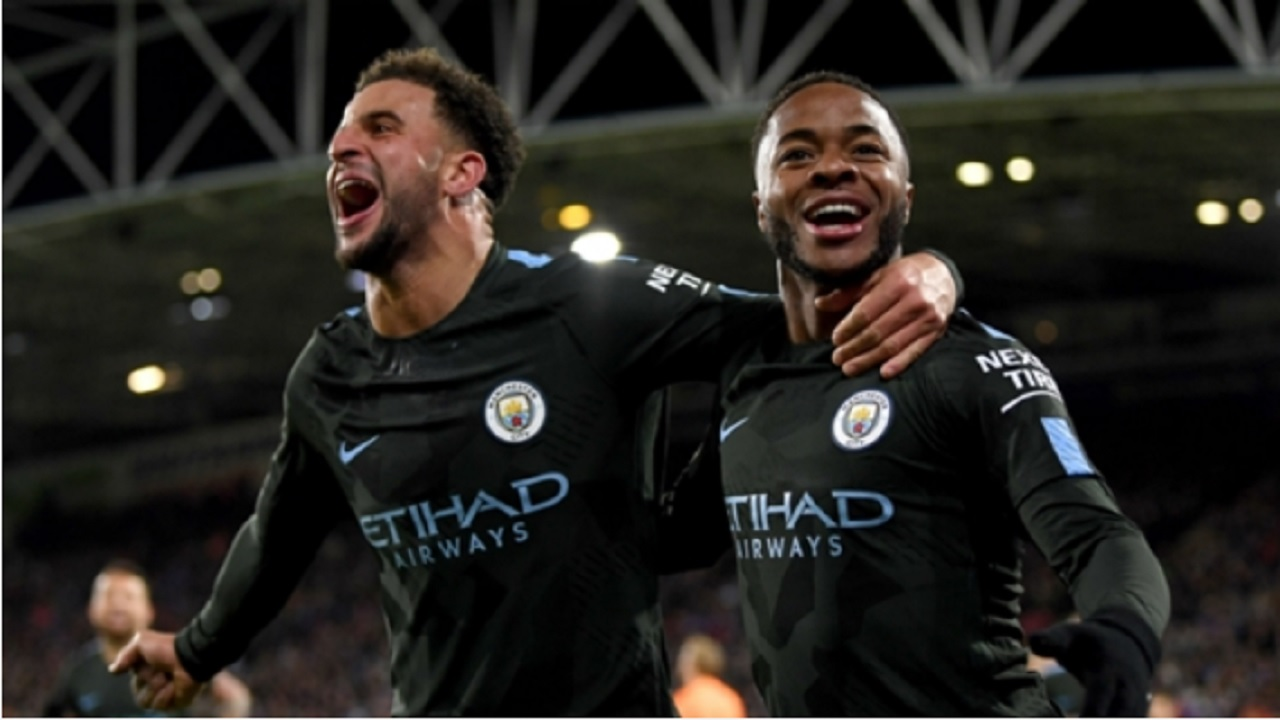 Raheem Sterling (right) celebrates with Kyle Walker.