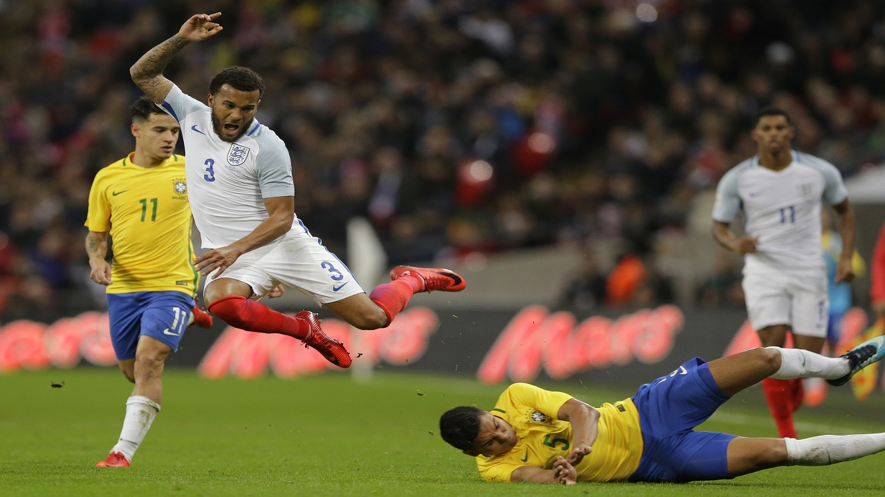 Brazil's Casemiro's tackle sends England's Ryan Bertrand to the turf during their international friendly football match at Wembley stadium in London, Britain, Tuesday, Nov. 14, 2017.