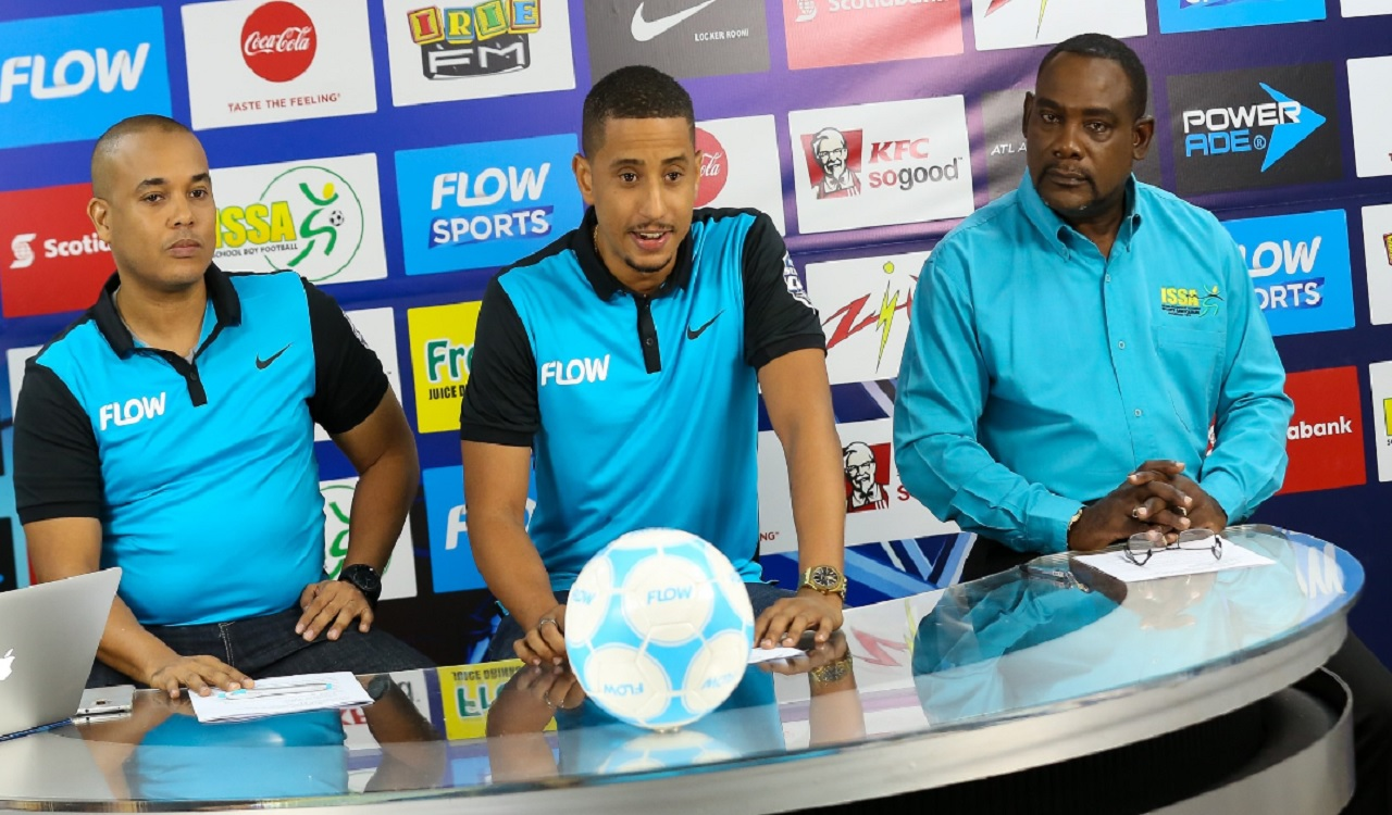 Sponsorship manager of FLOW Stephen Miller (centre) makes a presentation during an online press conference to launch the 2017 season of the FLOW Super Cup. Vice President of Marketing & TV FLOW Carlo Redwood is at left and President of the Inter-Secondary Schools Sports Association, Dr Walton Small is at right.