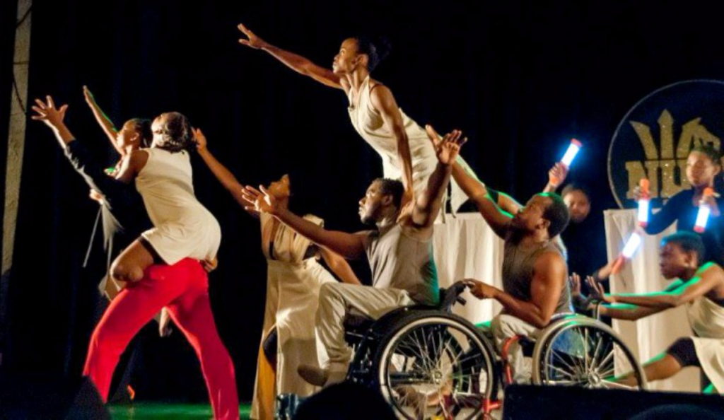 Christopher Gilkes is part of the Gemini Project dance group. (center)