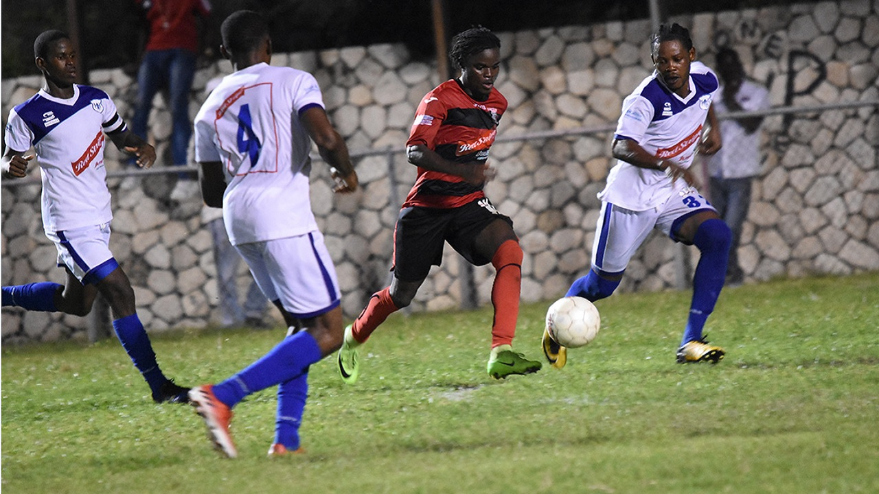 Action from the Red Stripe Premier League game between defending champions Arnett Gardens and Reno at the Anthony spaulding Sports Complex on Wednesday night. Arnett won the game 5-0.
