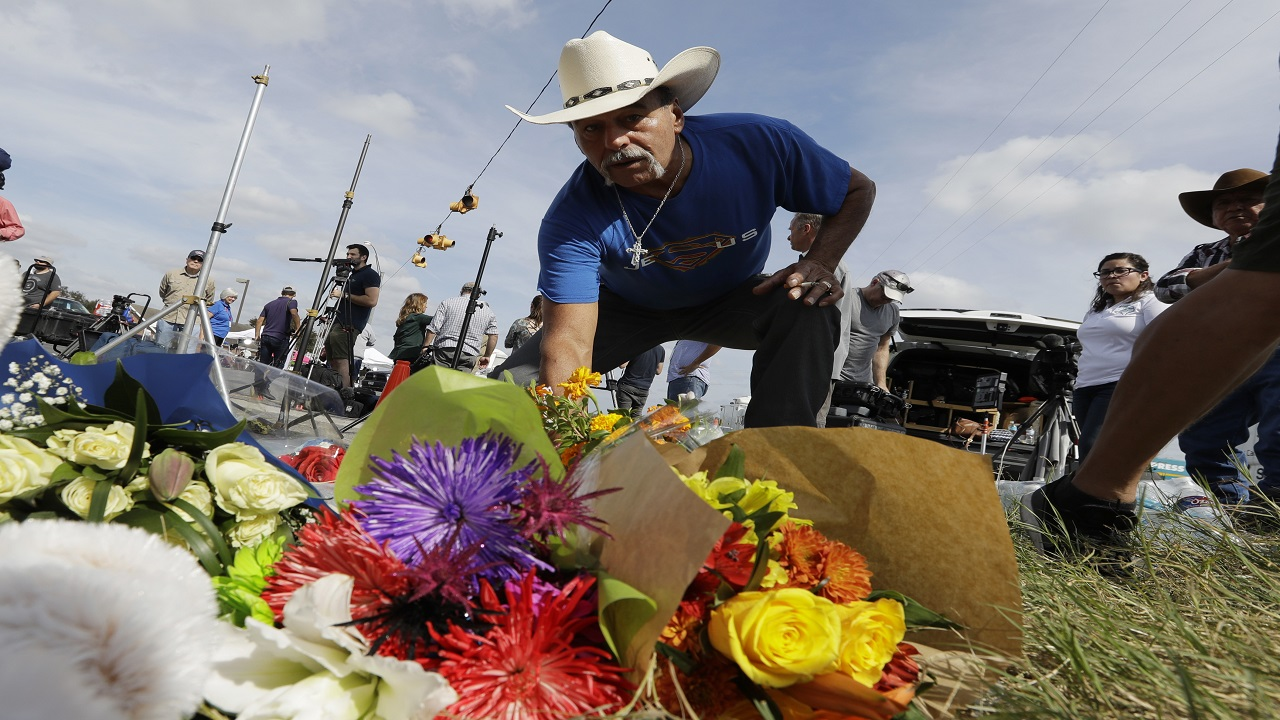 Rene Moreno drops off flowers at a makeshift memorial at the scene of a shooting at the First Baptist Church of Sutherland Springs, Tuesday, Nov. 7, 2017, in Sutherland Springs, Texas.