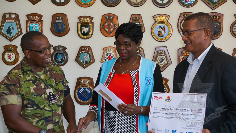 (L-R) Commander Aquinas Clarke, Deputy Chief of Staff of the BDF; Adorial Maxwell-Hazell, Founder/President – Precious Touch Foundation; and CEO of Digicel (Barbados) Ltd. Alex Tasker. (PHOTO courtesy BDF)