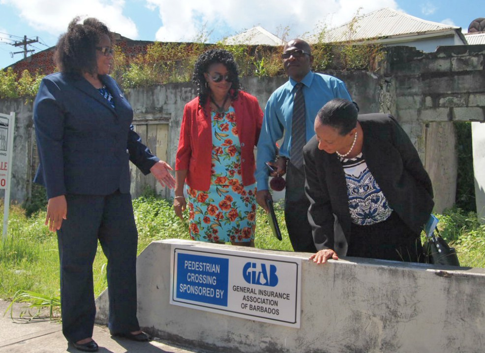 (l-r) Gina Welch, Administrator with the General Insurance Association of Barbados (GIAB); President of the Barbados Road Safety Association (BRSA) Sharmane Roland-Bowen; President of GIAB, Michael Holder and Permanent Secretary in the Ministry of Transport and Works, Nicolla Simone-Rudder.
