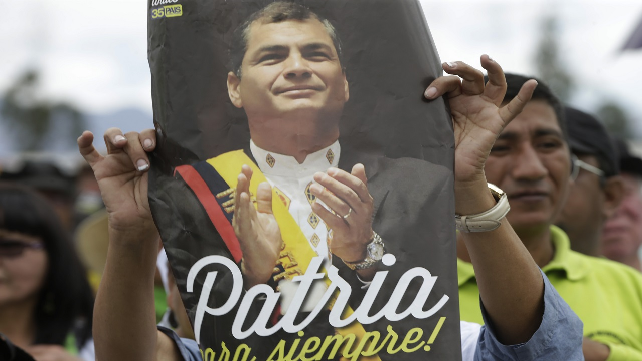 In this July 10, 2017 file photo, supporters of Ecuador's former President Rafael Correa gather to bid him farewell before he departs for Belgium to live with his family, from Quito, Ecuador.
