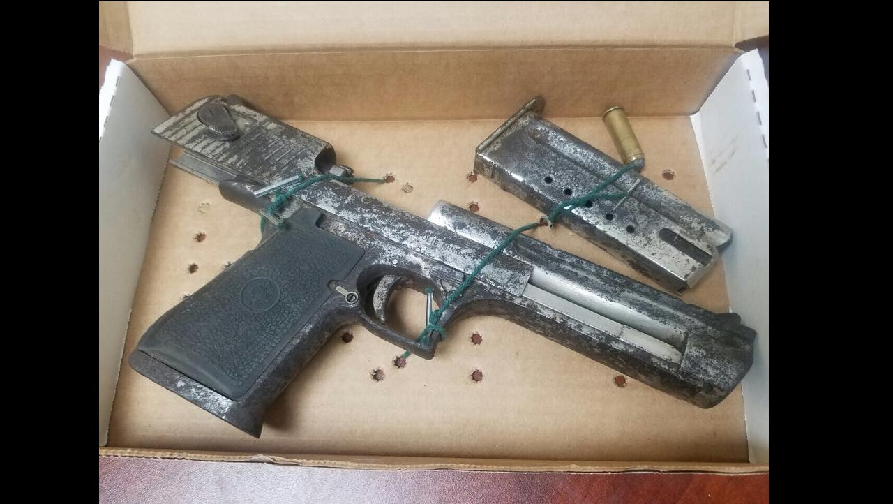 The Desert Eagle 9mm pistol found in Denham Town on Thursday.