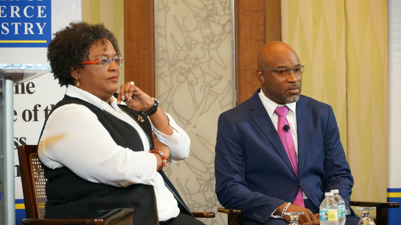 (left) Opposition Leader, Mia Mottley and Paul Ashby (right), moderator of the  Barbados Chamber of Commerce and Industry (BCCI) discussion. 