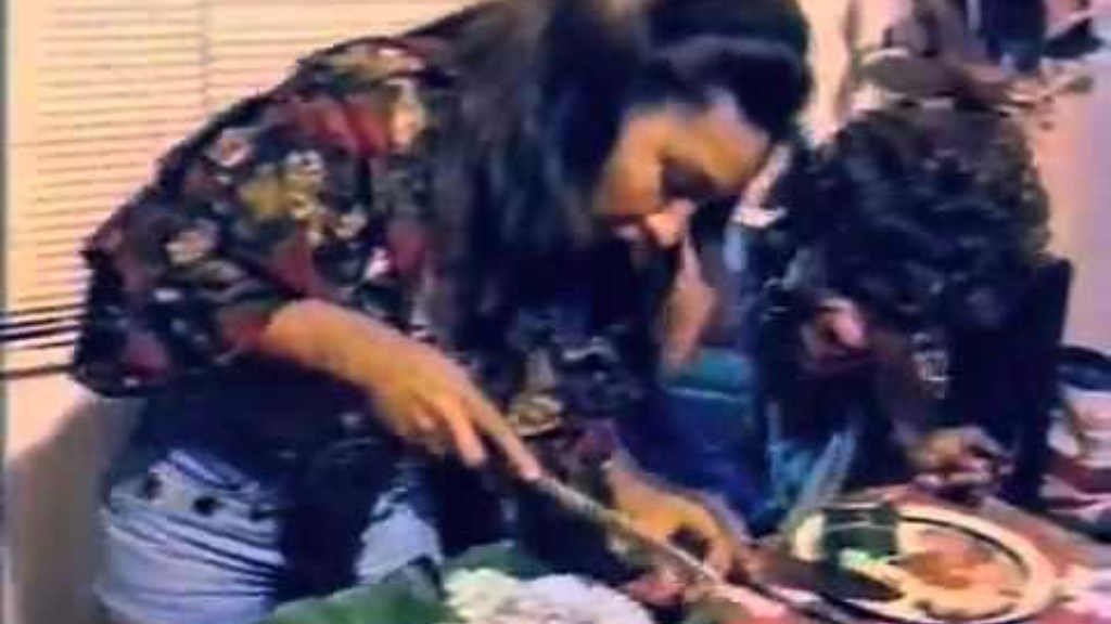 Soca parang queen Marcia Miranda slices up ham for her neighbour in the music video for her 1992 hit 'Bring out de Ham'.
