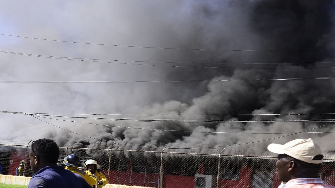 Smoke engulfs the Geddes Refrigeration facility in Kingston on Thursday morning. (PHOTOS: Marlon Reid)