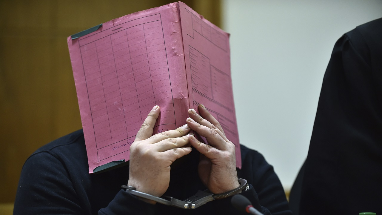 The Jan. 22, 2015 file photo shows former nurse Niels Hoegel covering his face during his trial at the regional court in in Oldenburg, northern Germany. The prosecutors in Oldenburg on Thursday, Nov. 9, 2017 said that he might have killed more than 100 people based on a toxicologic investigation.