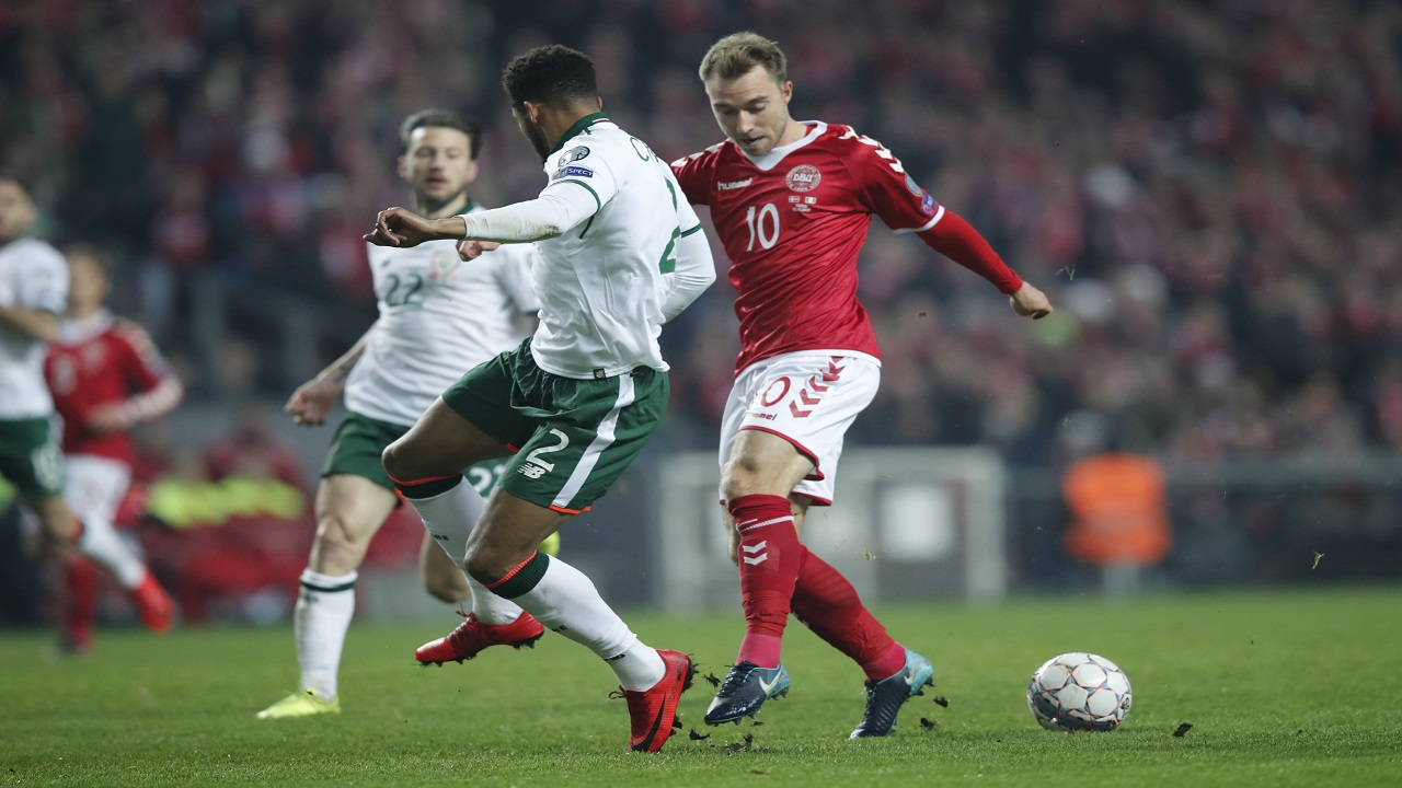 Ireland's Cyrus Christie and Denmark's Christian Eriksen , right, vie for the ball during the World Cup qualifying play-off first leg football match at Parken stadium in Copenhagen, Denmark, Saturday, Nov. 11, 2017.