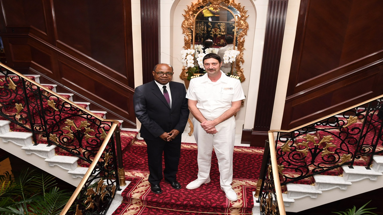 Tourism Minister Edmund Bartlett takes a moment with Captain Maroje Brajcic along one of the stately stairways onboard the MS Insignia