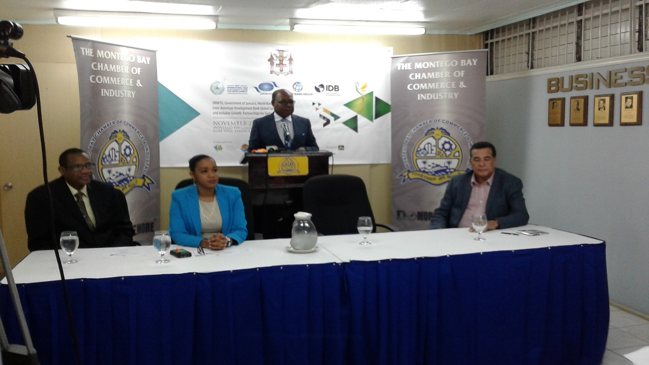 Tourism Minister Edmund Bartlett addresses journalists.
